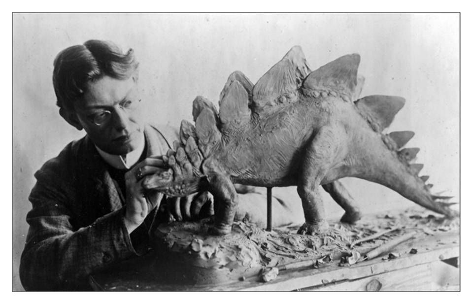 Picture of Charles R. Knight working on Stegosaur model
